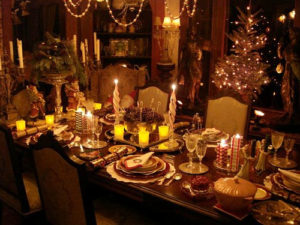 Holiday dining table with a spread of food on it.