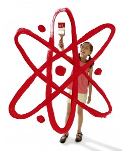 Image of girl painting an atom