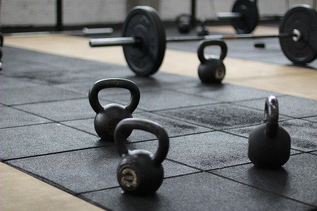 kettlebells, barbells with loaded weight on the floor.