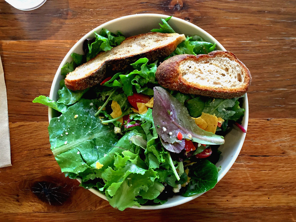 salad with sliced bread on the side.