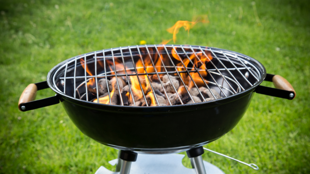 Charcoal grill with flame