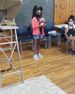camper showing their egg design